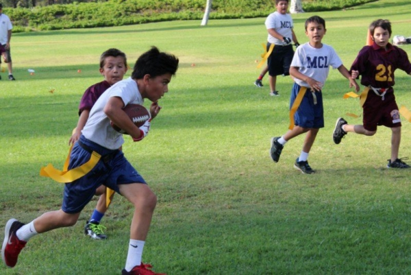 MCL's JV Football running for a touchdown.